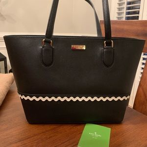 Kate Spade black handbag with ivory color ric rac